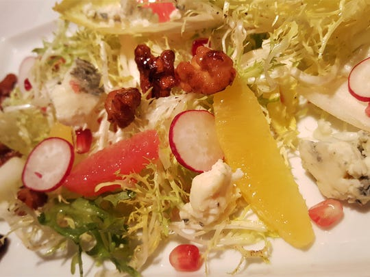 Endive with orange, grapefruit pomegranate, valdeon