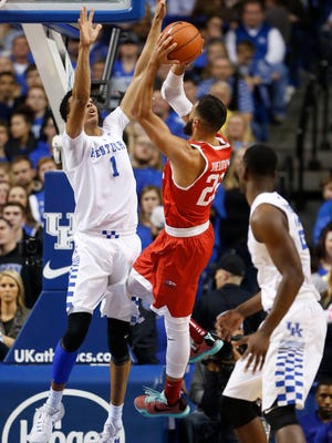 Nov 24, 2015; Lexington, KY, USA; Boston University Terriers forward Nathan Dieudonne (22) shoots the ball as Kentucky Wildcats forward Skal Labissiere (1) defends in the first half at Rupp Arena.