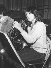High school age Alice Calabrese plays her French horn.