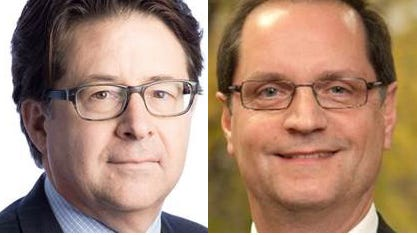 """Defense attorneys Dean Strang, left, and Jerry Buting come to the stage of Royal Oak Music Theatre for """"A Conversation on 'Making a Murderer.'"""""""
