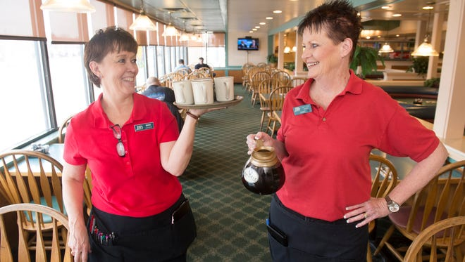 Marie Voeller-Sutich, left, and Sandy Ulmen have a combined 77 years of serving customers at JB's restaurant.  Voeller-Sutich has 40 years at the restaurant and Ulmen 37 years.