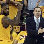 Cleveland Cavaliers head coach David Blatt yells at his team as LeBron James (23) looks on during overtime of Game 3 of the Eastern Conference finals of the NBA basketball playoffs against the Atlanta Hawks in Cleveland. Blatt was handed a star-studded team expected to win an NBA title, but not a handbook on how to get the Cavaliers to the top. For Blatt, who left his family in Israel to pursue his dream, the journey has been difficult with speculation about his future partly undermining his success.