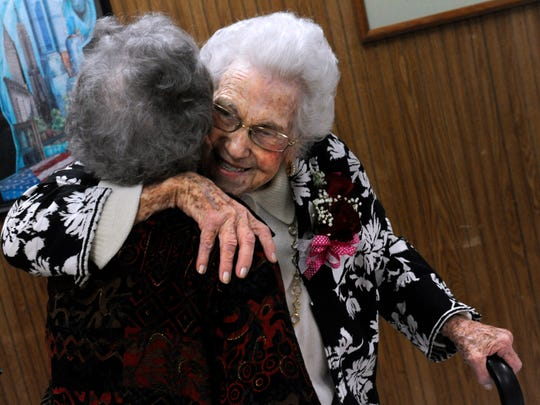 """Ferne Lee gives a hug to Bettie Loper, who has lived across the street from Lee for more than 20 years. """"We're neighbors, not friends,"""" Loper joked. """"No, we are friends, we see each other every day."""""""