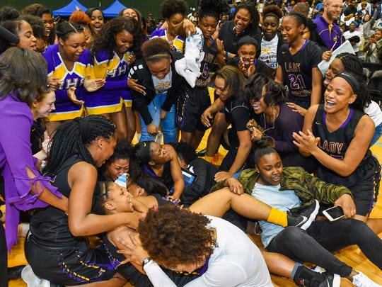 Hattiesburg players celebrate following their last-second win over West Jones during the MHSAA Girls 5A Championship Game held at The Coliseum in Jackson.