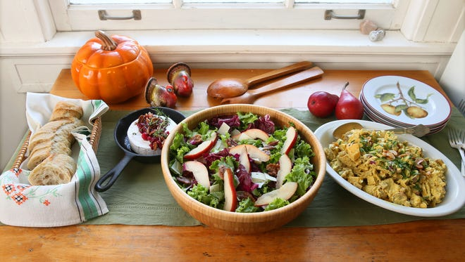 Baked brie topped with cranberries and pecans, a fall apple salad with candied pecans and a curried chicken salad with fruit and cashews make up a serve-yourself menu ideal for a holiday planning party.