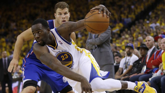 Former MSU star Draymond Green (23) had four points, five assists and five rebounds Sunday in Golden State?s 118-97 win over Blake Griffin and the Los Angeles Clippers.  AP Golden State Warriors' Draymond Green (23) dribbles past Los Angeles Clippers' Blake Griffin during the second half in Game 4 of an opening-round NBA basketball playoff series on Sunday, April 27, 2014, in Oakland, Calif. Golden State won 118-97. (AP Photo/Marcio Jose Sanchez)