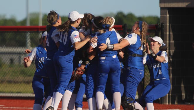 The Oak Creek softball team celebrates the final out of the WIAA Division 1 sectional final against Kenosha Bradford on June 1.