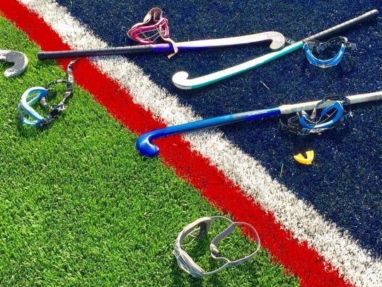 John Jay field hockey equipment strewn about the school's