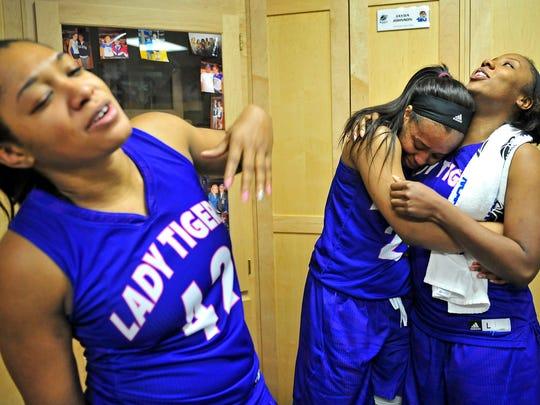 TSU senior Briana Morrow, right, gets a hug from Jayda