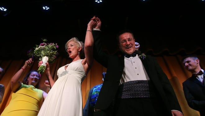 Audrey and Nick Rozanov whoop it up with guests during their wedding ceremony with Fred Armstrong. The couple embraced the quirky by asking guests to wear something they have worn from previous weddings such as old bridesmaid gowns, and handed out kazoos.