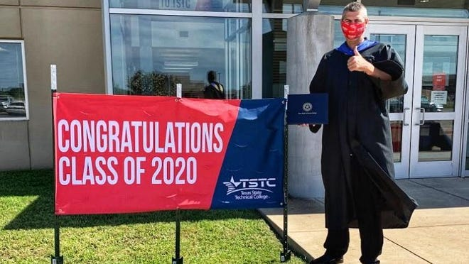 Marcus Balch, provost of Texas State Technical College's North Texas campus in Red Oak, greets spring graduates at a drive-in celebration on Friday.