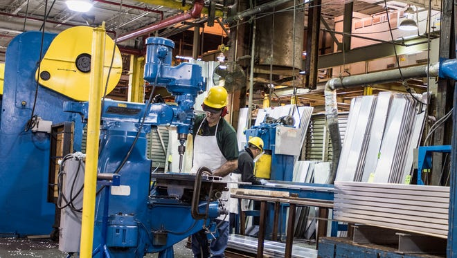 Workers drill and fashion aluminum at Aluminum Shapes plant in Pennsauken.