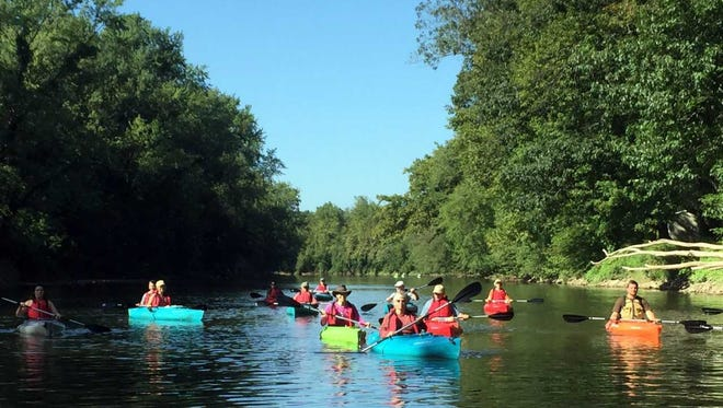 A group of kayakers, using equipment rented from Cocoa Kayakers, take a leisurely float down the Swatara Creek