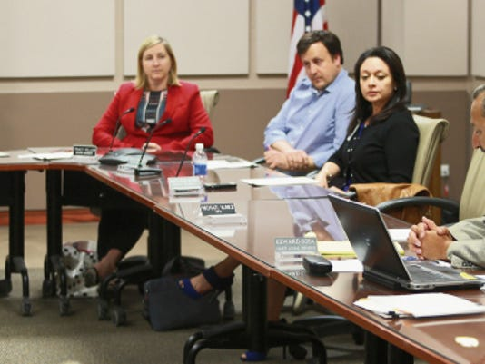 VICTOR CALZADA-EL PASO TIMES UMC Board of Managers Chief Legal Officer Edward Sosa, right, addresses the board after it came out of executive session Monday. Other board membes are Chair Steve DeGroat, Stacy Yellen, Miguel Fernandez and Monica Salaiz-Narvaez..