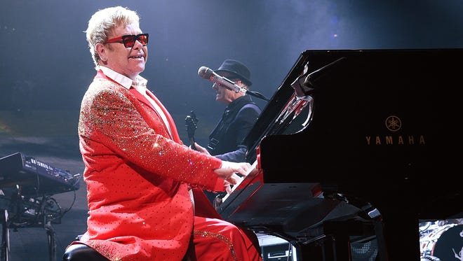 Musician Elton John performs at the Barclays Center on December 31, 2014 in the Brooklyn borough of New York City.
