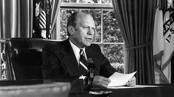 President Gerald Ford pardons Richard Nixon in the