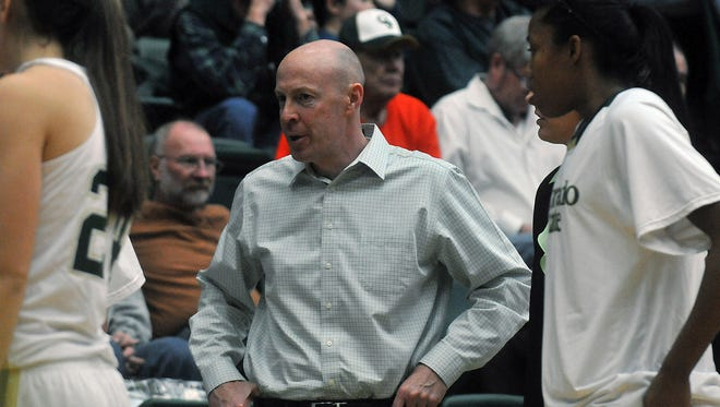 Tim Moser, an assistant coach for the CSU women's basketball program for the past six seasons, listens in during a timeout in a 2012 game against San Diego State at Moby Arena. Moser is leaving CSU to become head coach of the men's basketball team at Eastern Wyoming.