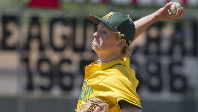 Manogue pitcher Connor Brewster throws during the 2013 Division I North Regional tournament.