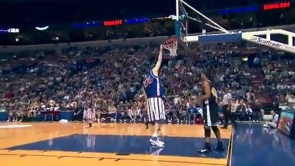 Texas Legends center Paul Sturgess - seen here with the Harlem Globetrotters - can dunk without jumping.