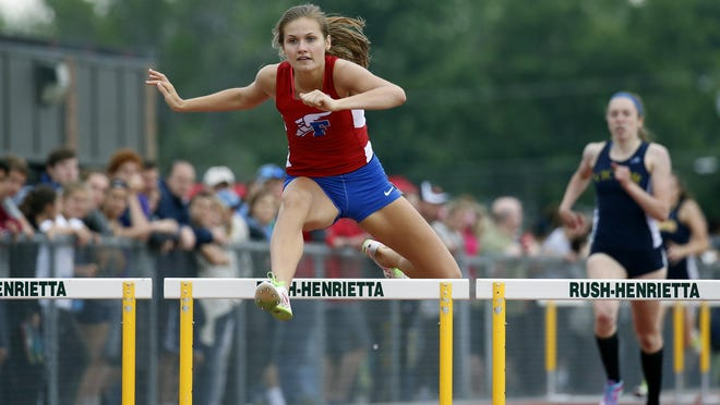 Fairport's Sinead Sargeant wins the Class AA 400-meter hurdles in 1:02.11 during the Section V Track and Field Championships at Rush-Henrietta High School.