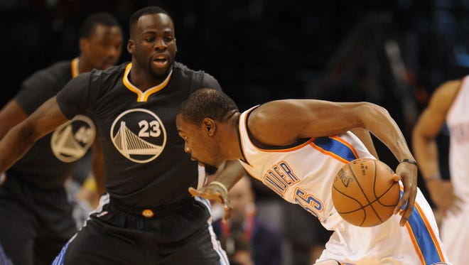 Oklahoma City Thunder forward Kevin Durant (35) drives to the basket in front of Golden State Warriors forward Draymond Green (23) during the second quarter at Chesapeake Energy Arena.