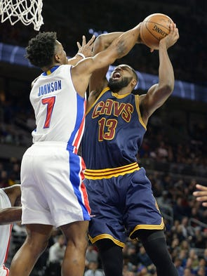 Pistons' Stanley Johnson defends the Cavaliers' Tristan