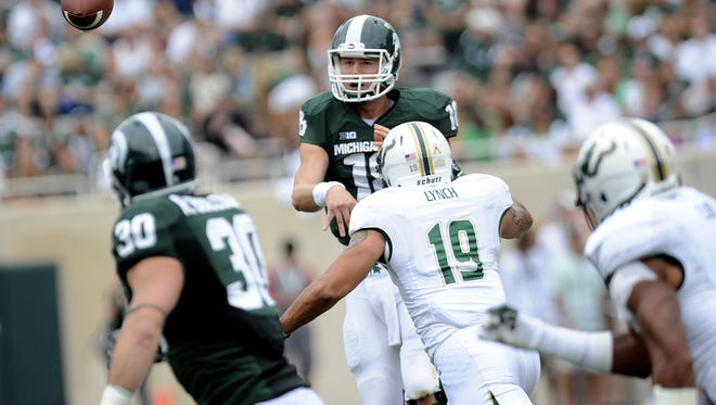 MSU quarterback Connor Cook tosses a pass to Riley Bullough in the first quarter of Saturday's game against South Florida. MSU struggled but won, 21-6.