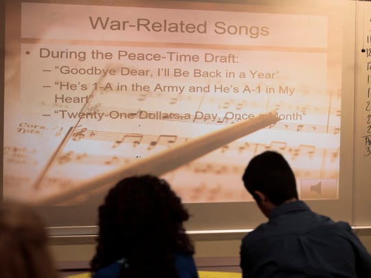 Students listen to lesson on music from World War II during a 1940s symposium at South Louisiana Community College's Early College Academy in Lafayette Nov. 15, 2016.