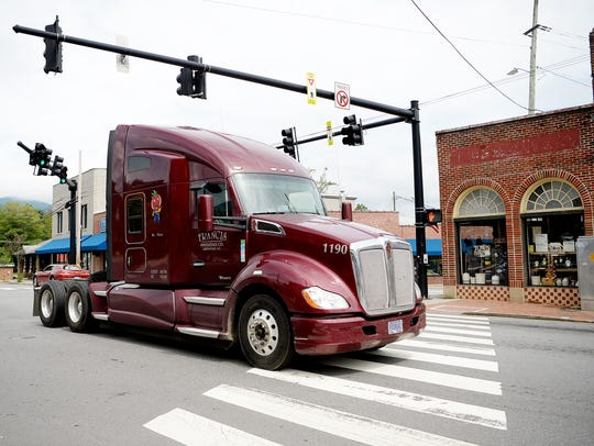 A truck drives on State Street in Black Mountain August