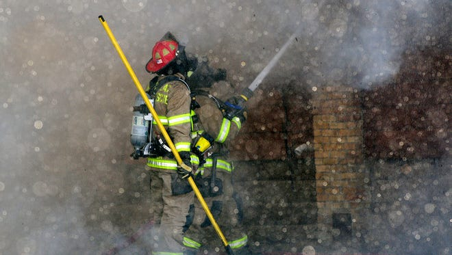 A photo from an arson on Hickory Street prior to a police standoff at The Elms on Monday, Dec. 9, 2013.