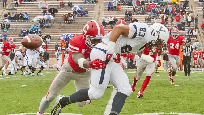 Cornell's Del Barnes looks to finish his tackle on Yale's Robert Clemons after knocking the ball loose. during the first half of a game at Schoellkopf Field in Ithaca, N.Y., on October 4, 2014.