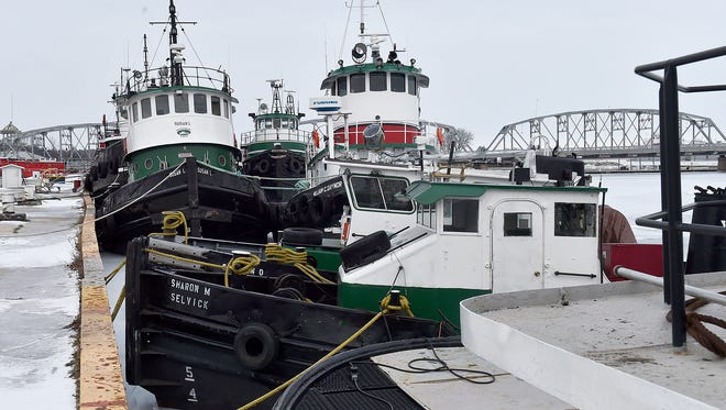 Seven tugboats of the Selvick fleet are moored between bridges in downtown Sturgeon Bay. Selvick Marine Towing Corp. representative Steve Selvick was the guest of the Maritime Speakers Series Thursday night.
