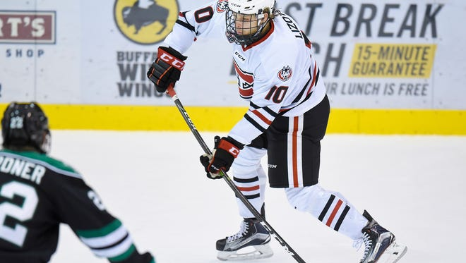 St. Cloud State's Jon Lizotte takes a shot at the goal against the University of North Dakota during the first period Saturday, Nov. 19, 2016, at the Herb Brooks National Hockey Center.