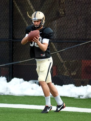 Purdue's Thomas Meadows catches the ball before punting it during spring football practice at the Bimel Practice Complex, in West Lafayette, on Friday, March 29, 2013.
