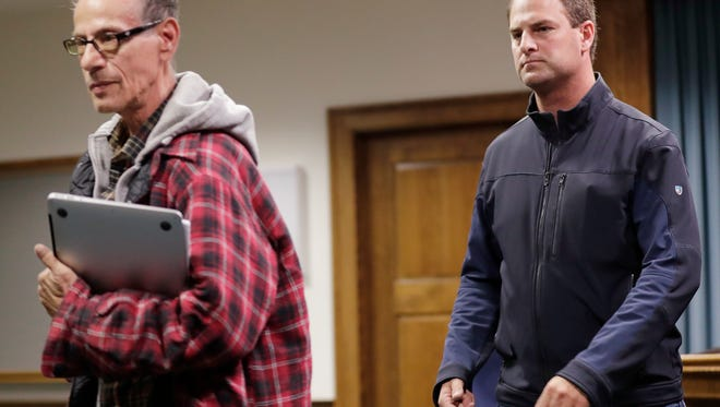Ralph Barke (left) and Troy Lasecki leave a courtroom after a hearing at the Brown County Courthouse on Tuesday, October 24, 2017 in Green Bay, Wis.