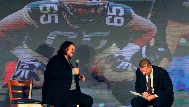 Mark Tauscher, left, the Red Smith Award winner, is interviewed by Dave Edwards as the 53rd Red Smith Banquet on Tuesday in Appleton.