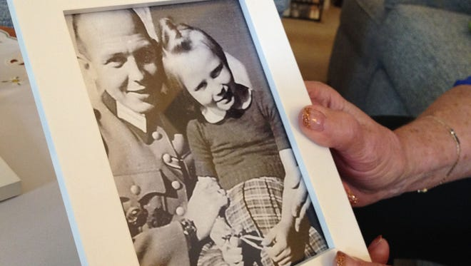 Christel Jonge Vos shares memorabilia from her childhood in Germany during World War II at her home in Keizer, Ore.