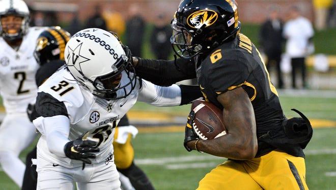 Missouri Tigers wide receiver J'Mon Moore (6) runs the ball as Vanderbilt Commodores cornerback Tre Herndon (31) attempts the tackle on Nov. 12, 2016. Missouri won 26-17.