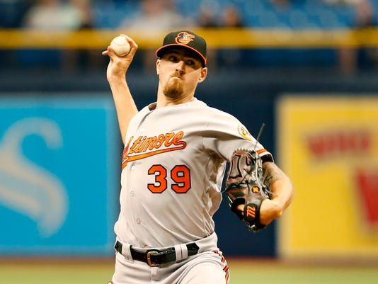 orioles pitcher kevin gausman will wear no 34 to honor roy halladay