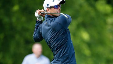 Adam Scott (AUS) hits a shot  during the first round of the 2016 Wells Fargo Championship at Quail Hollow Club.