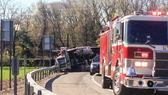 A tractor-trailer hauling trash flipped over the northbound 1-95 ramp to I-287 in Rye on Wednesday morning, causing a major delay on northbound I-95 in the area.