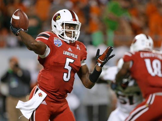 Louisville quarterback Teddy Bridgewater throws a pass against Miami during the first half of the Russell Athletic Bowl NCAA college football game in Orlando, Fla., Dec. 28, 2013.