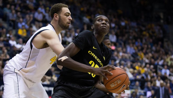 Feb 11, 2016; Berkeley, CA, USA; Oregon Ducks forward Chris Boucher (25) controls the ball against California Golden Bears center Kameron Rooks (44) during the second half at Haas Pavilion. The California Golden Bears defeated the Oregon Ducks 83-63. Mandatory Credit: Kelley L Cox-USA TODAY Sports