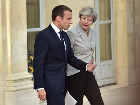 Britain's Prime Minister Theresa May (R) and France's