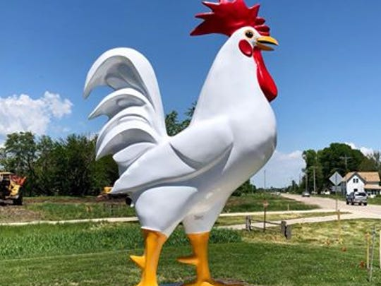 A large chicken statue had to be removed at the new restaurant The Chicken because it violated West Des Moines' sign code.