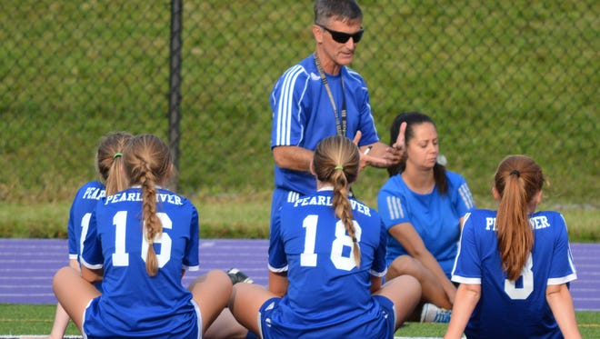 Pearl River girls soccer coach talks with his team at halftime of Tuesday's 1-1 tie at John Jay-Cross River.