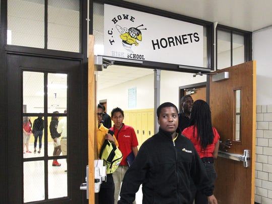 Middle school students change classes on the third floor of Howe High School, 4900 Julian Ave., Indianapolis, on Aug. 30, 2013. Howe is about to enter its third year as one of the Indianapolis Public Schools takeover schools.