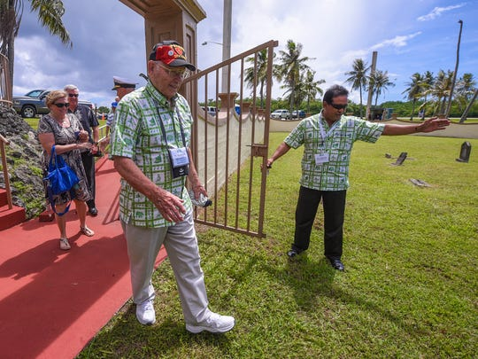 Guam liberator Gene Bell arrives at the Sumay Cemetery