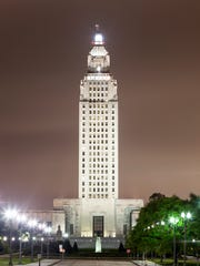 The State Capitol tower in the city of Baton Rouge illuminated at night. Louisiana, United States