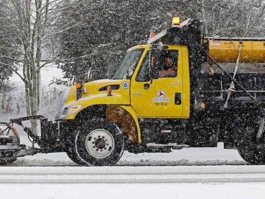 A snowplow operator clears U.S. Highway 70 near Hillsborough,